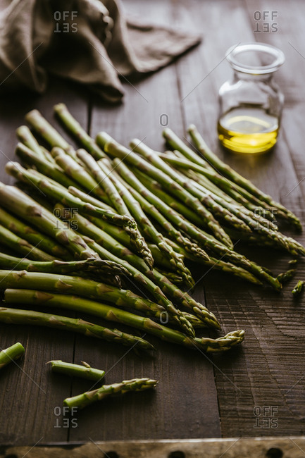 Jumble of asparagus on a wooden table