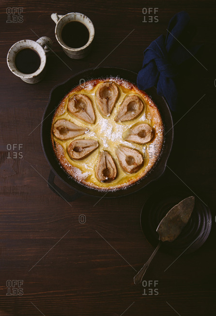 Overhead shot of pear clafoutis with coffee