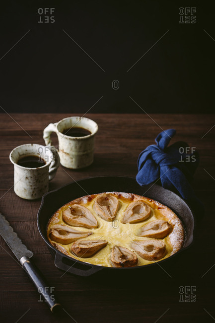 Pear clafoutis on wooden table