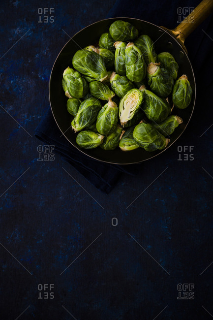 Copper pan filled with Brussels sprouts