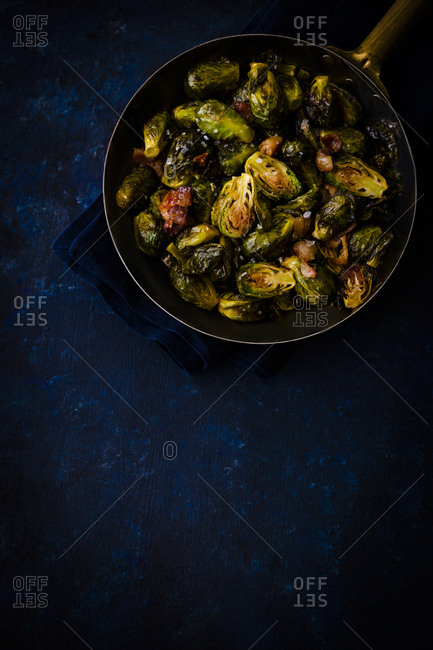 Copper pan filled with fried Brussels sprouts