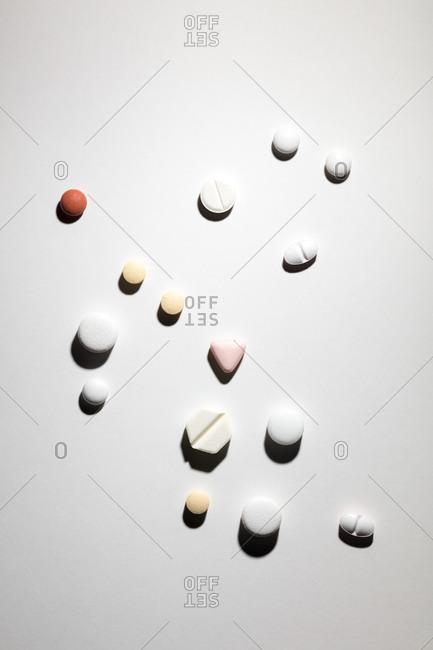 Various pills against white background