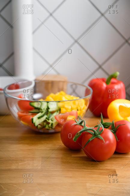 Salad ingredients at wooden kitchen countertop