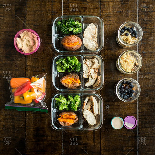 Overhead view of healthy meals prepared in glass containers
