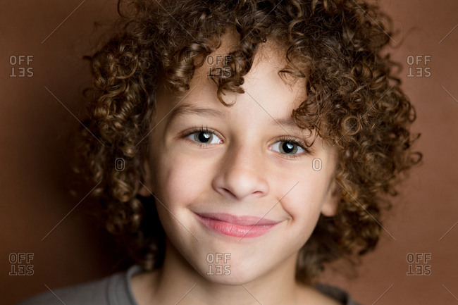 Close up of young mixed race boy smiling