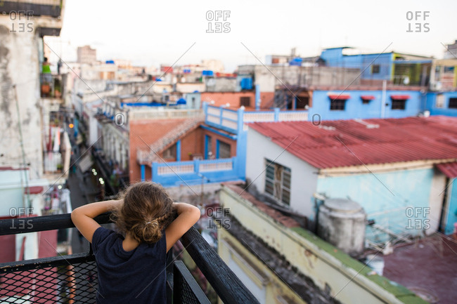 Girl looking over the rooftops of Havana Vieja