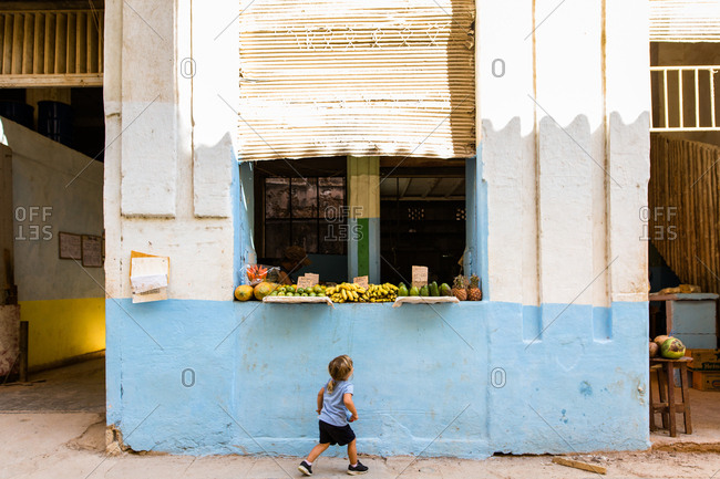 Havana, Cuba - November 14, 2016: Young child fruit shopping