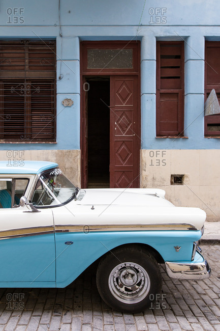 Havana, Cuba - November 15, 2016: A vintage blue and white car on the street