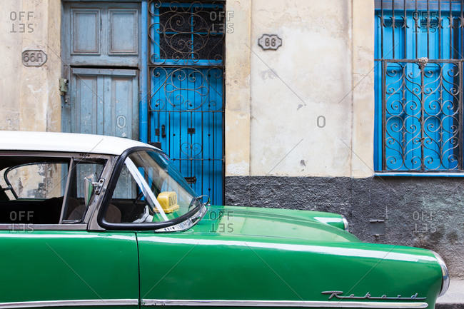 Havana, Cuba - November 15, 2016: A vintage green taxi on the street