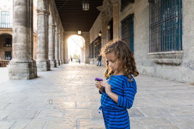 Girl holding a flower in Havana, Cuba