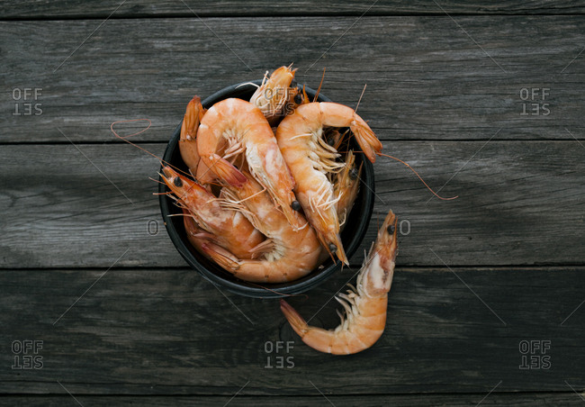 Prawns in a bowl on a wooden table