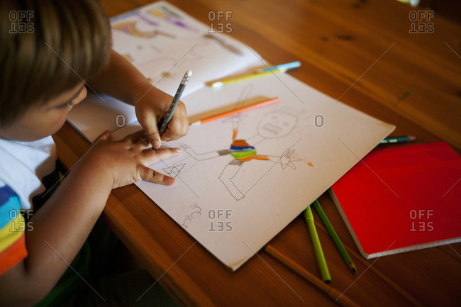 Little boy drawing pictures