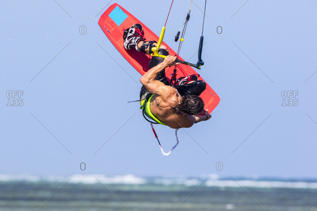 Man kiteboarding in midair