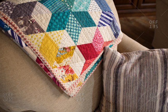 Colorful quilt on back of sofa