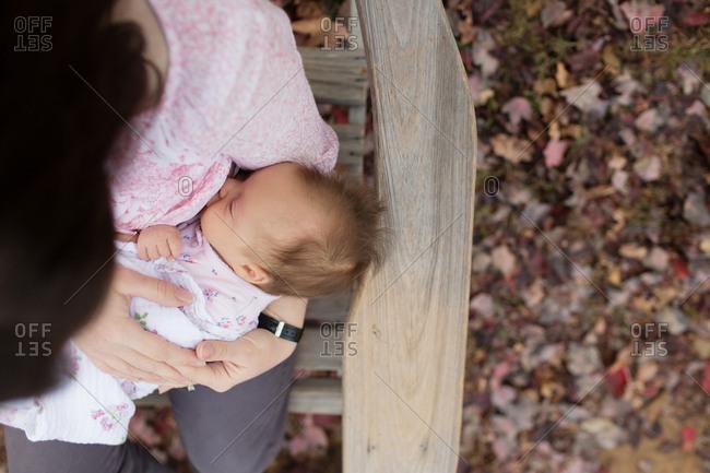 Overhead view of mother nursing baby outdoor