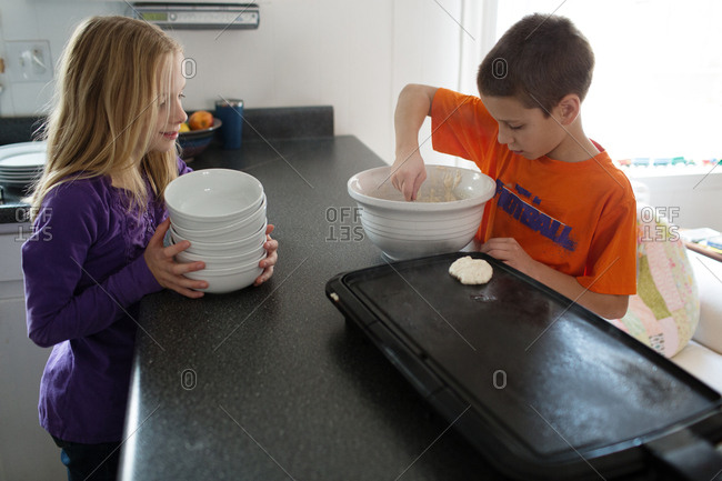 Brother and sister making pancakes