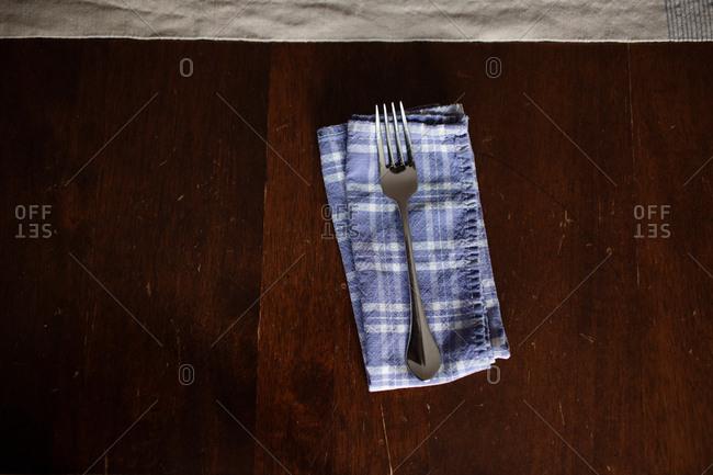 Fork on folded blue napkin
