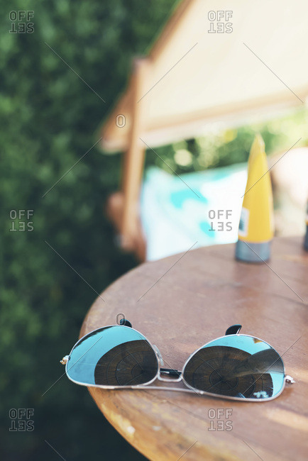 Sunglasses on table outdoors