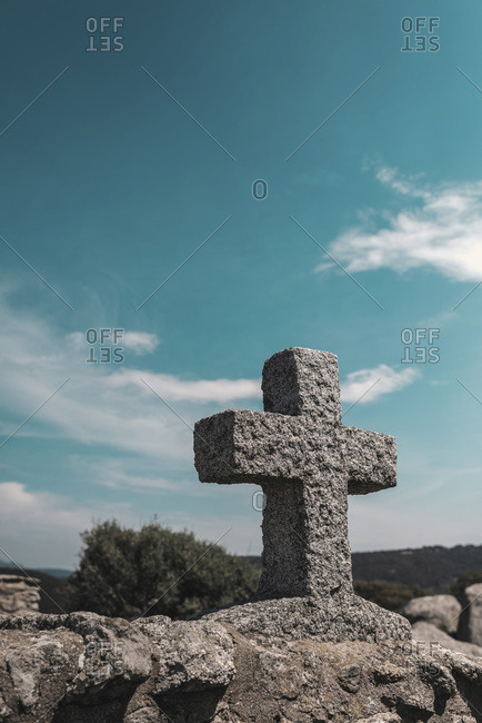 Stone cross on top of a tomb