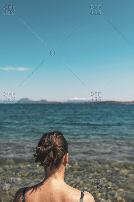 Rear view of woman looking out to sea