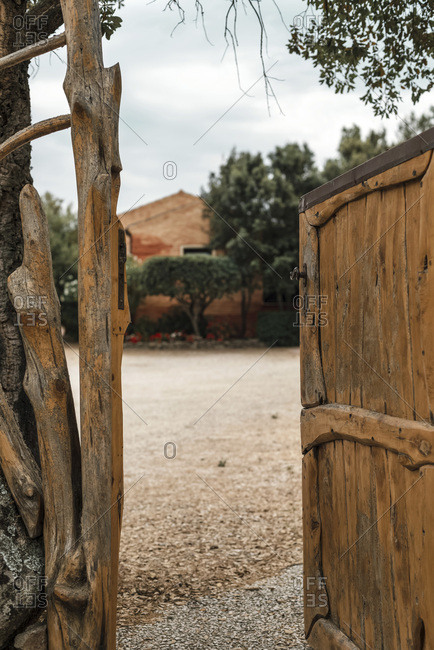 Open rustic gate on a ranch