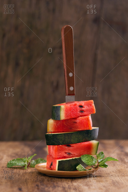 Stack of watermelon with knife