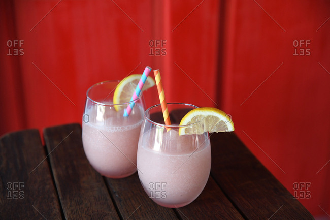 Two pink frozen cocktails