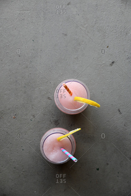 Overhead view of two pink frozen cocktails