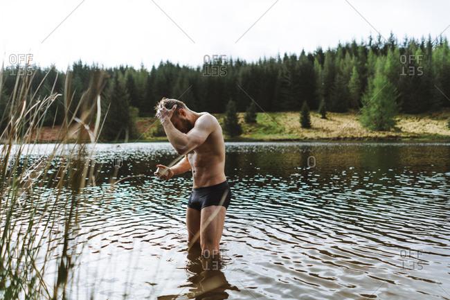 Man bathing in natural Iceland lake