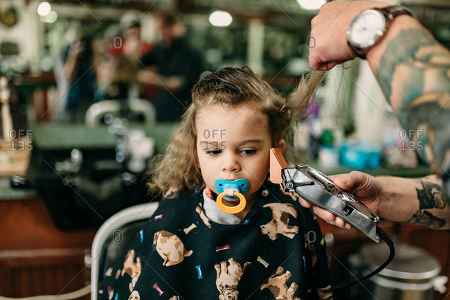 Little boy's first haircut at the barbershop