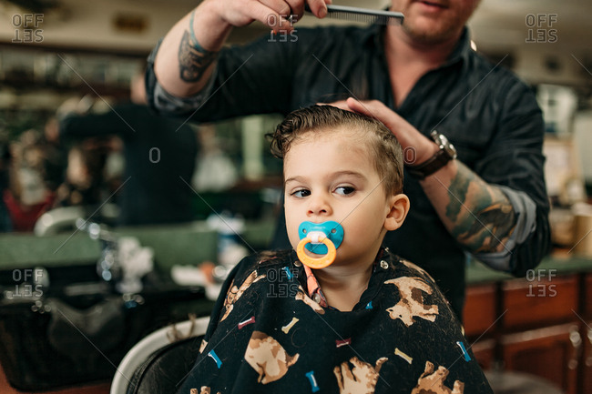 Barber combing toddler's hair