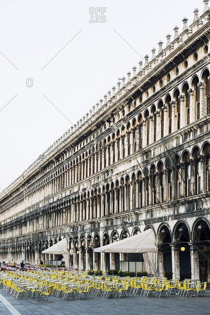 Rows of chairs arranged in front of cafes in the Piazza San Marco, Venice, Italy