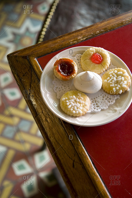 Plate of cookies on corner of table of coffee shop