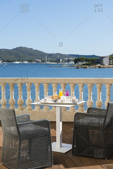 Porto Vecchio, France - September 6, 2016 -Hotel breakfast served on balcony overlooking the bay