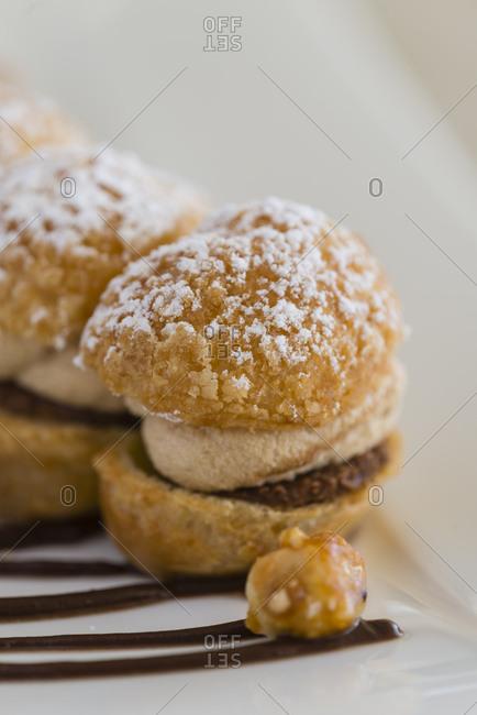 Close up view of row of Paris Brest pastries
