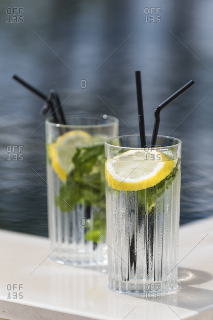 Refreshing glass of cold water with lemon and mint served overlooking the bay