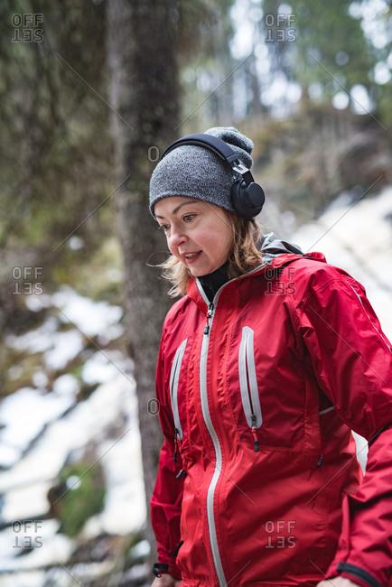 Woman running in winter landscape