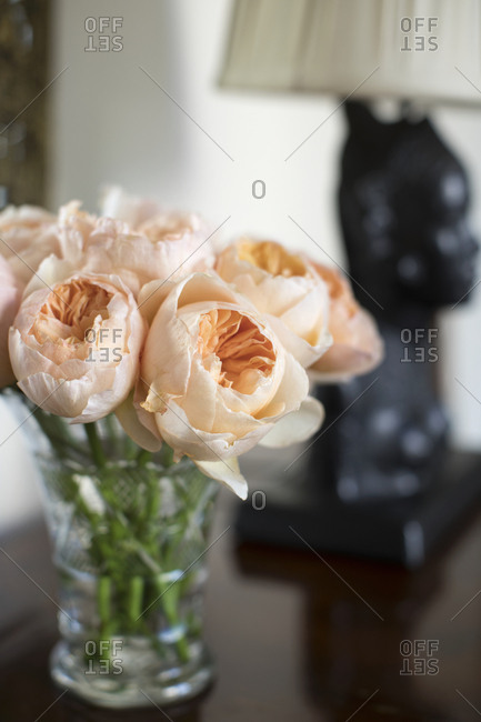 Bouquet of peach colored flowers on end table
