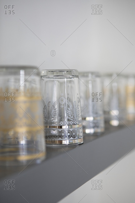 Decorative glasses stored upside down on shelf