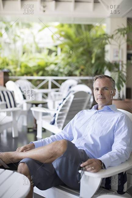 Man relaxes on resort porch