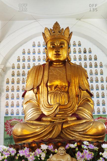 Penang, Malaysia - June 29, 2012: Golden statue in Kek Lok Si Temple