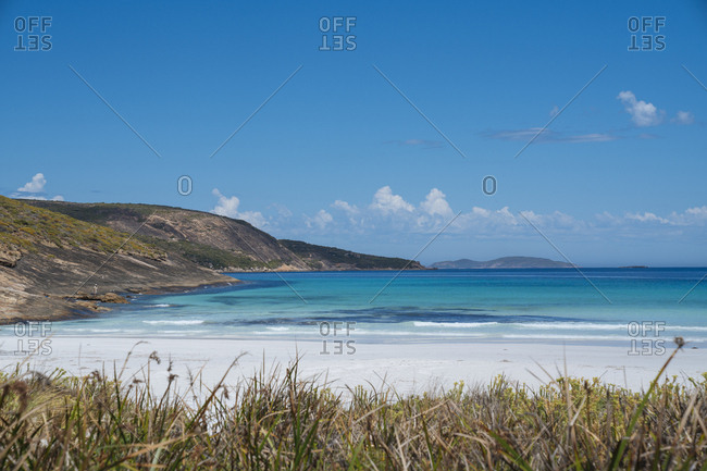 Scenic view of white sand beach and coastal bluffs at Cape Le Grand National Park in Western Australia