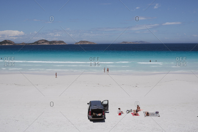 Esperance, Australia - February 9, 2018: Car parked and people relaxing on the beach at Lucky Bay in Cape Le Grand National Park