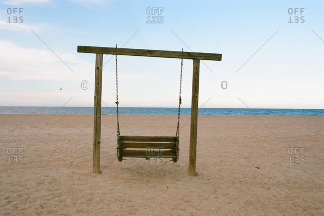 Hand made wooden swing set on deserted beach