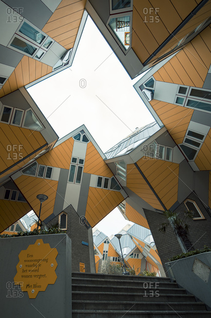 Rotterdam, Netherlands - June 07, 2018: Low angle view of intertwined forest of cubic houses by architect Piet Blom