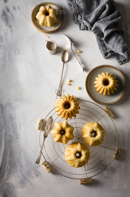 Mini vanilla Bundt cakes of various shapes served with vanilla glaze