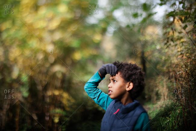 Ethiopian girl standing in the woods