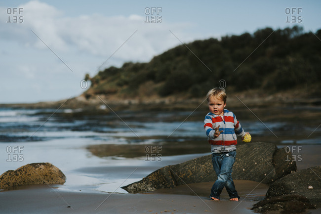 Toddler boy playing on the beach