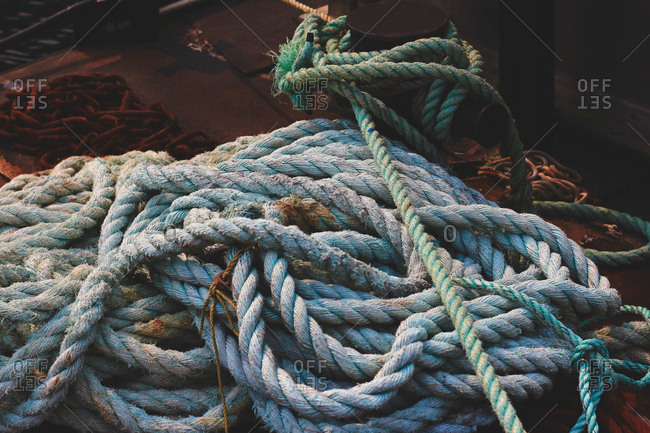 Piles of rope lying on deck of ship