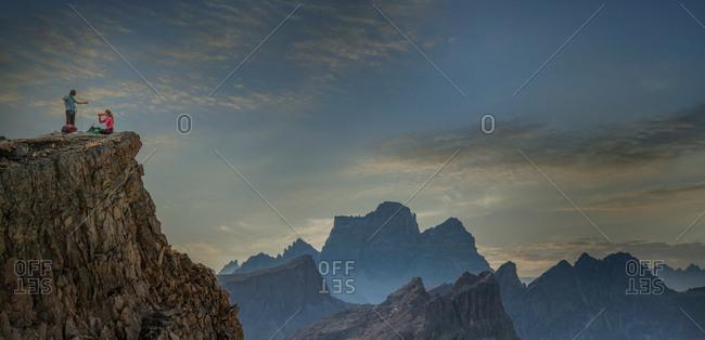 Climbers on mountain top, Dolomites, Cortina d'Ampezzo, Veneto, Italy